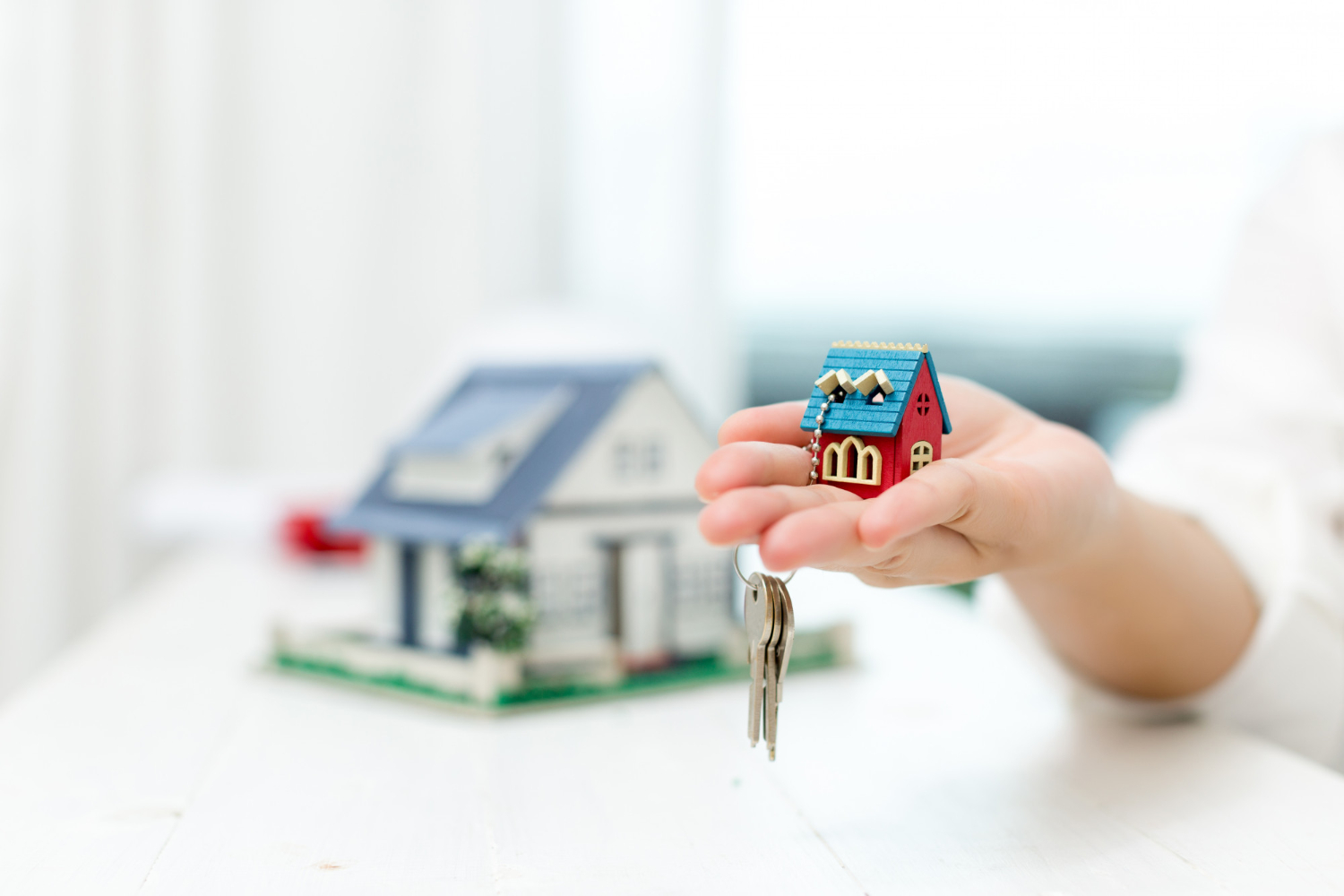 keyring of a house being held
